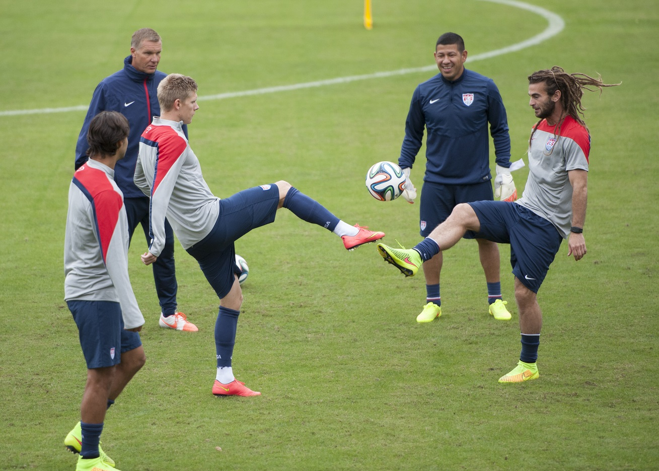 United States forward Aron Johannsson (left) and midfielder Kyle Beckerman (right) try to control a ball before practice at Sao Paulo FC's training ground in Sao Paulo, Brazil on June 20, 2014.
